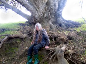 Frances on root of her spirit tree