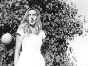 Jennifer (Frances' daughter) in summer dress against balloon tree