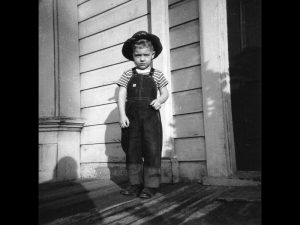 Three-year-old Timmy, stoic, uprooted from Boston, MA, to Portland, OR, in 1950